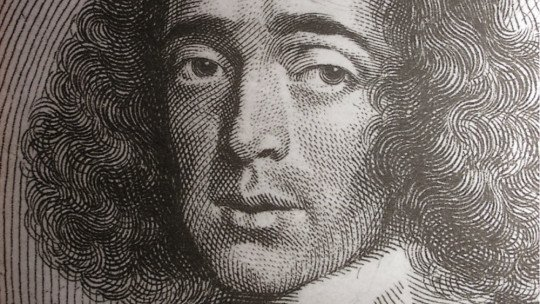 What was Spinoza's God like and why did Einstein believe in him?